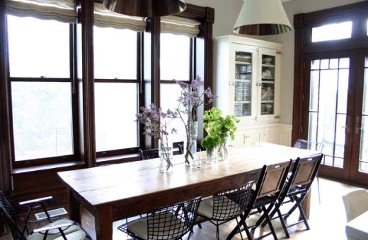 wabi sabi dining room with floral branch arrangement